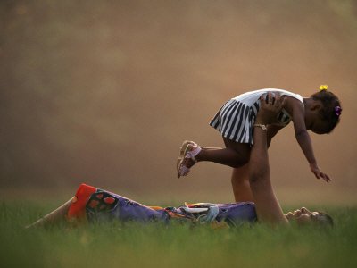 mother-and-daughter-playing-in-grass